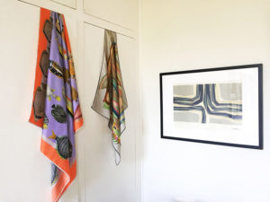 colorful fish motif scarves hanging on the wall