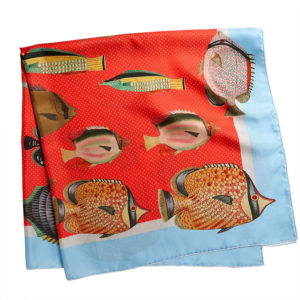 printed red silk twill scarf with colorful fishes folded