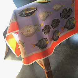 cut out printed silk twill scarf hanging on the rack