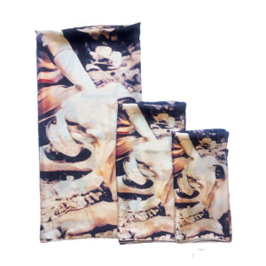 three folded scarves with dog prints