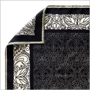 edge of silk twill scarf with machine rolled hem finishing