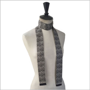 maannequin with long narrow printed silk twill scarf