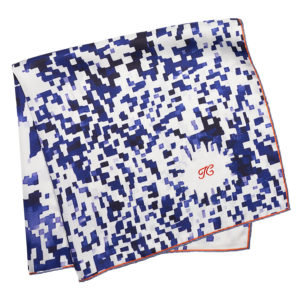 red initial embroidered on folded blue floral printed silk scarf