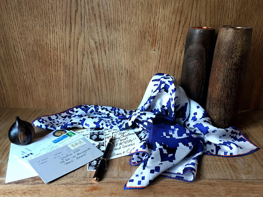 printed blue silk scarf with letters photos and pen