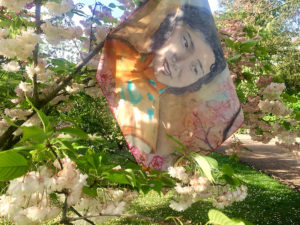 printed silk scarf of portrait painting on cherry blossoms