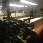silk getting woven by machine