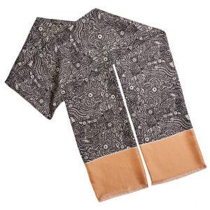 black and beige arabesque printed silk twill scarf folded