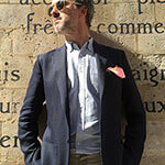 man in sunglasses with pink pocket square