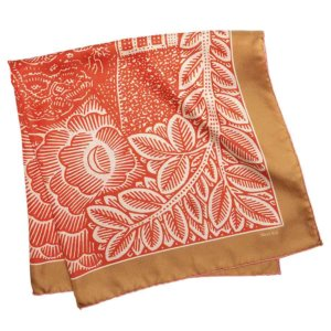 neighborhood printed orange and tan silk scarf folded