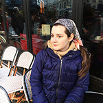 silk head scarf on a young woman in a cafe