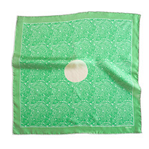 green and white printed silk scarf with circle in the middle