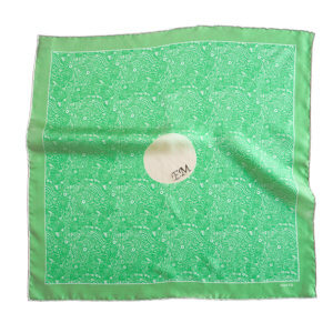 green and white silk scarf with initial embroidery in the center