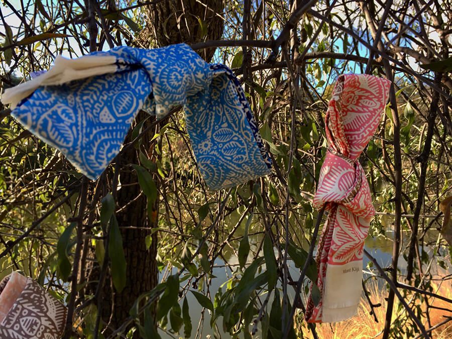 pink and blue long skinny silk scarves tied on a tree