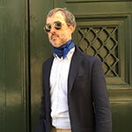 polka dot blue silk scarf on a man