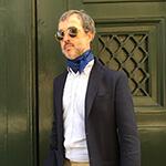 polka dot blue silk scarf on a man