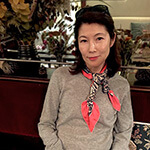 grey and pink silk scarf in knots on a woman