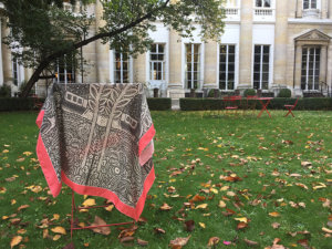 grey and pink silk scarf on a chair in a French garden