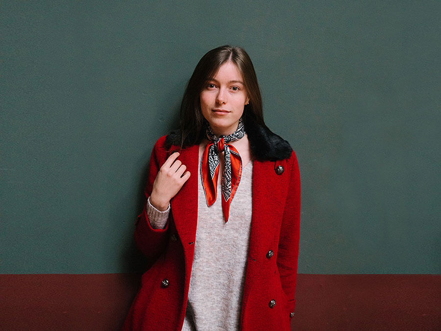 navy and red silk scarf on a woman in red coat