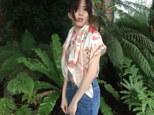 algae printed white scarf on a woman in exotic garden