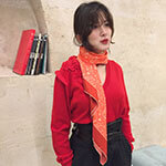 woman with red arabesque silk scarf and red sweater