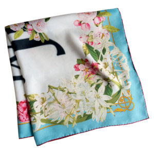 light blue framed silk scarf with romantic flowers folded