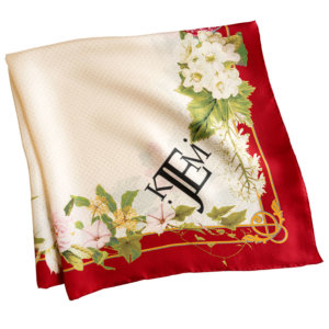 red framed silk scarf with romantic flowers folded
