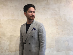 man in grey with grey pocket square