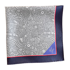 grey and white pocket square with blue tip folded