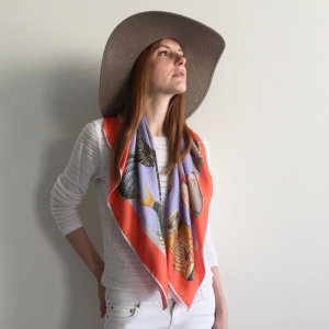 fish printed lavender silk scarf with orange boarder on woman