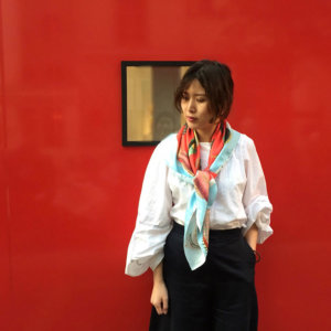fish printed red silk scarf with blue boarder on woman