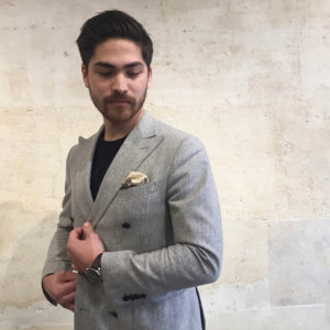 man with black and cream arabesque silk pocket square