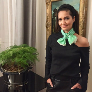 green arabesque punted silk scarf tied as a bow