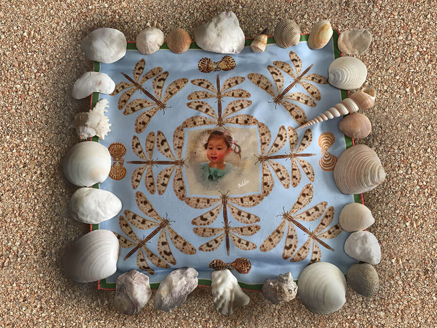 silk scarf with little girl surrounded by dragonflies and shells