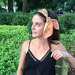 young woman with cactus printed terra-cotta silk scarf on head