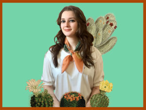 woman with cactus printed terra-cotta color scarf tied