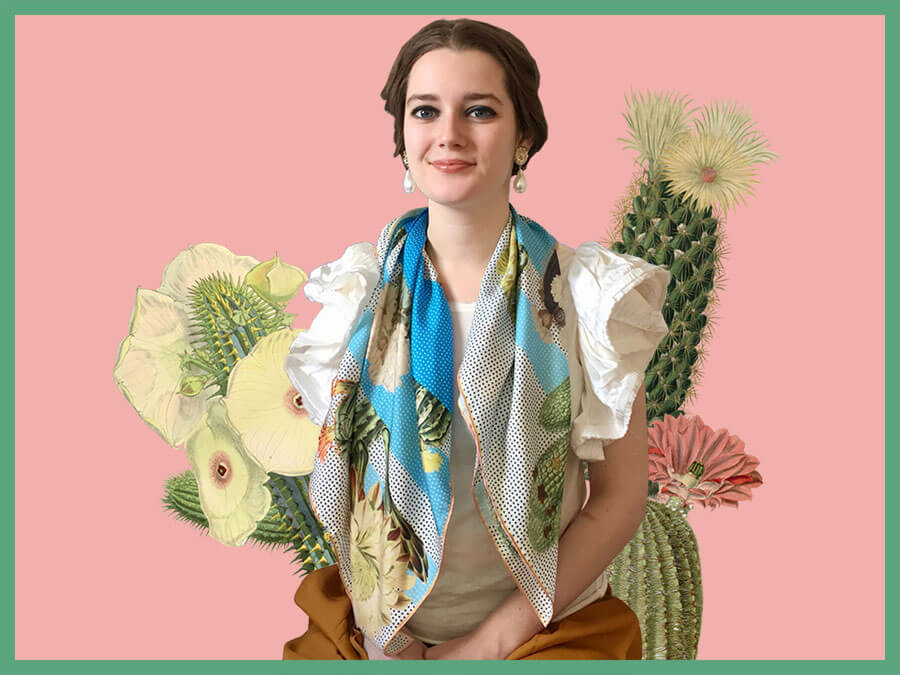woman with cactus printed big blue and white silk scarf