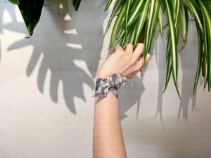 light blue and white leaf printed silk wristband on tied