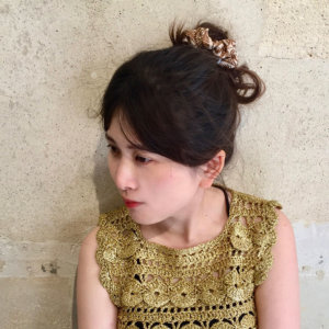 leaf printed brown silk hair scrunchy on woman