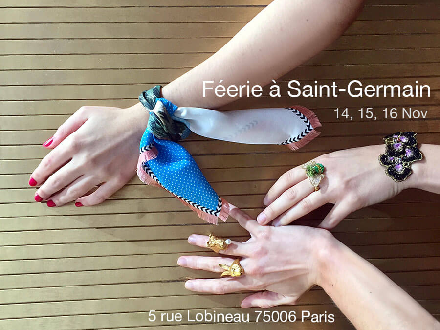 three hands with silk scarf, rings and a brace