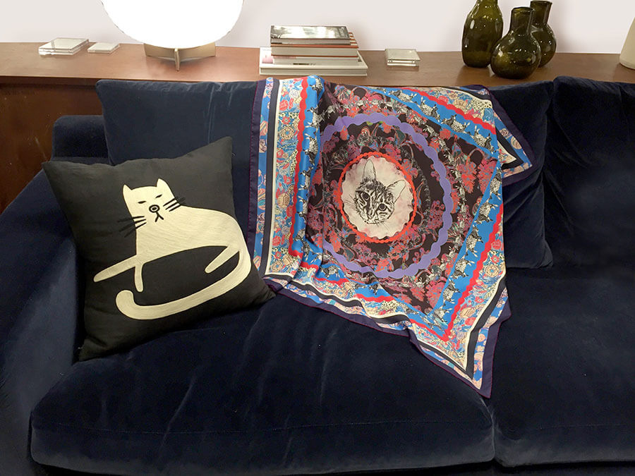 all over cat printed silk scarf next to cat cushion