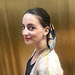 gold butterfly printed dark silk scarf tied around ponytail