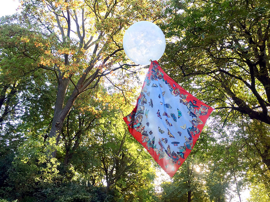 all over butterfly printed red and blue silk scarf on a balloon