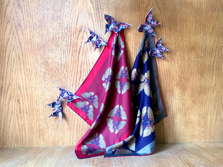 pair of butterfly printed silk scarves with origami butterflies